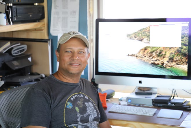 Jim Fraser sits in his home office of his off-grid farm. Fraser became a StreetView photographer in 2013.