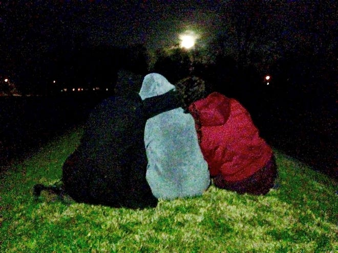 Elizabeth Weiser and friends sit and watch the northernleast moonrise, halfway through the 18.5 year cycle at the Octagon Earthworks in Newark in 2015.
