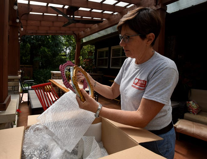 Dr. Tracee Laing, of Granville, founder of Healing Art Missions, with a package of external fixtures for complicated bone fractures donated from Nationwide Children's Hospital. The fixtures are being shipped to earthquake-ravaged Haiti as part of the organization's humanitarian aid.