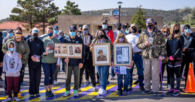 Pictured are veterans and civilians at the inaugural Western New Mexico University Remembrance March, held on campus where a memorial will be held on the 20th anniversary of the 9/11 attacks.