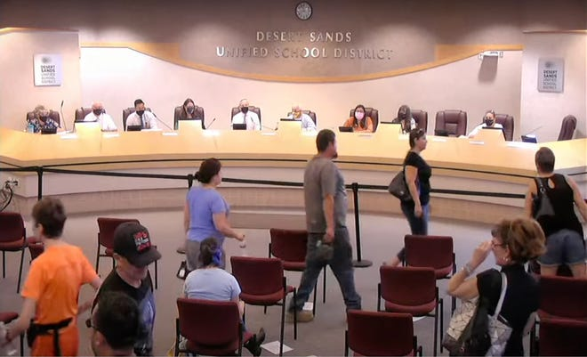 A screenshot of the Desert Sands streamed meeting on Aug. 31, 2021. Frustrated parents and students walk out of the ongoing meeting in protest of the district's mask mandate.