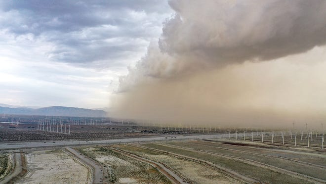 A large cloud of dust and wind moves through the Coachella Valley near the windmills in Palm Springs.  The front was moving east to west Tuesday, August 31, 2021.