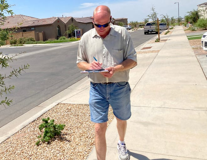 Tom Vanek, one of the canvassers for Liz Harris' Voter Integrity Project, sought out voters in Queen Creek on Saturday, Aug. 28, 2021.