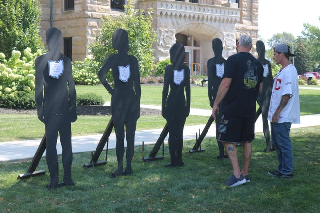 Those in the local recovery community take time to reflect on who they have lost due to overdose from Ottawa County in 2020, which were represented with these black silhouettes on display at the courthouse lawn as part of the Overdose Awareness Day held on Tuesday.