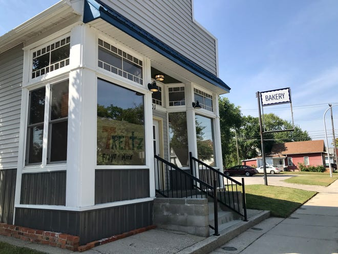 Signs stating that frozen yogurt shop Treatz will be coming soon can be seen in the windows at the former Betsy's Bakes building in Port Huron on Aug. 31, 2021.