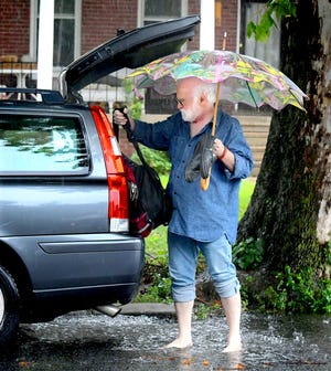 John Terlazzo of York City loads items into his car along Madison Avenue as remnants of former Hurricane Ida dump bands of rain in the region Wednesday, Sept. 1, 2021. The National Weather Service in State College predicted the county would get 3-4 inches of rain Wednesday. Bill Kalina photo