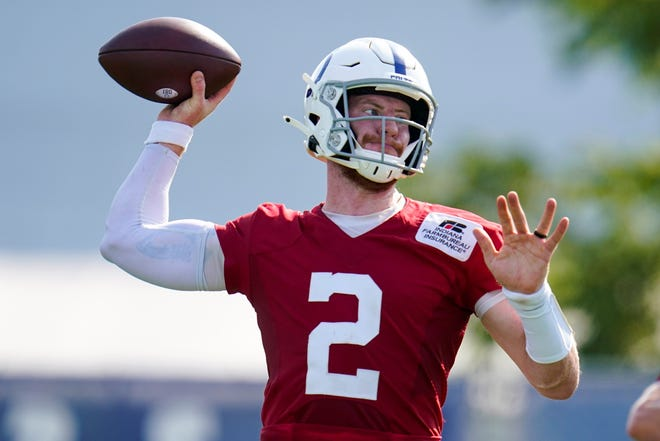 Indianapolis Colts quarterback Carson Wentz (2) throws during practice at the NFL team's football training camp in Westfield, Ind., Monday, Aug. 23, 2021. (AP Photo/Michael Conroy)