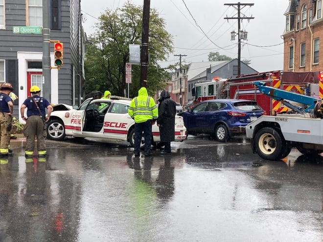 Firefighters respond to a collision at East King and South Queen streets in York.