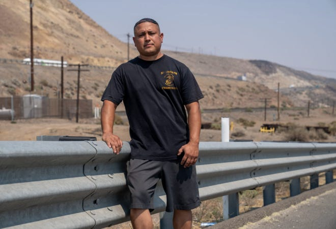 Stephen Lara, 39, stands near where he was pulled over in Feb. 2021 by Nevada Highway Patrol officials who seized his nearly $87,000 life savings and turned it over to the United States Drug Enforcement Administration.
