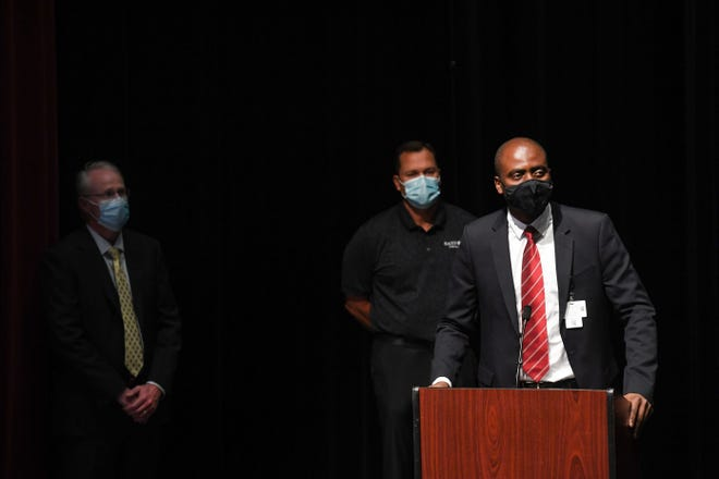 Dr. Charles Chima, public health director for the City of Sioux Falls, speaks at a podium while Dr. Mike Wilde, vice president medical officer, Sanford Sioux Falls and Dr. David Basel, vice president for clinical quality for Avera Medical Group stand behind to answer questions during a press conference regarding the ongoing COVID-19 pandemic on Wednesday, September 1, 2021 at the Washington Pavilion in Sioux Falls.