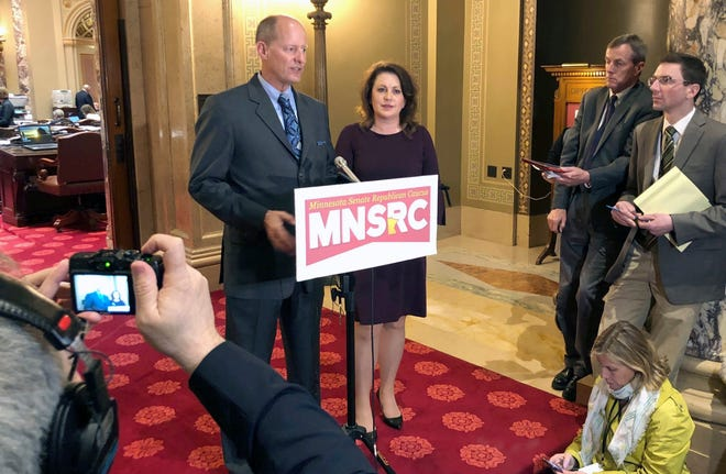 In this May 2, 2019 photo, Minnesota Senate Majority Leader Paul Gazelka, left, stands next Deputy Majority Leader Michelle Benson as he speaks to reporters at the Capitol in St. Paul. Benson has launched her campaign for Minnesota governor, saying she'll fight efforts to close schools and businesses or defund the police. Meanwhile, Gazelka, of East Gull Lake, is stepping down as Senate majority leader in a move widely seen as a precursor to announcing a run for governor. (AP Photo/Steve Karnowski, file)