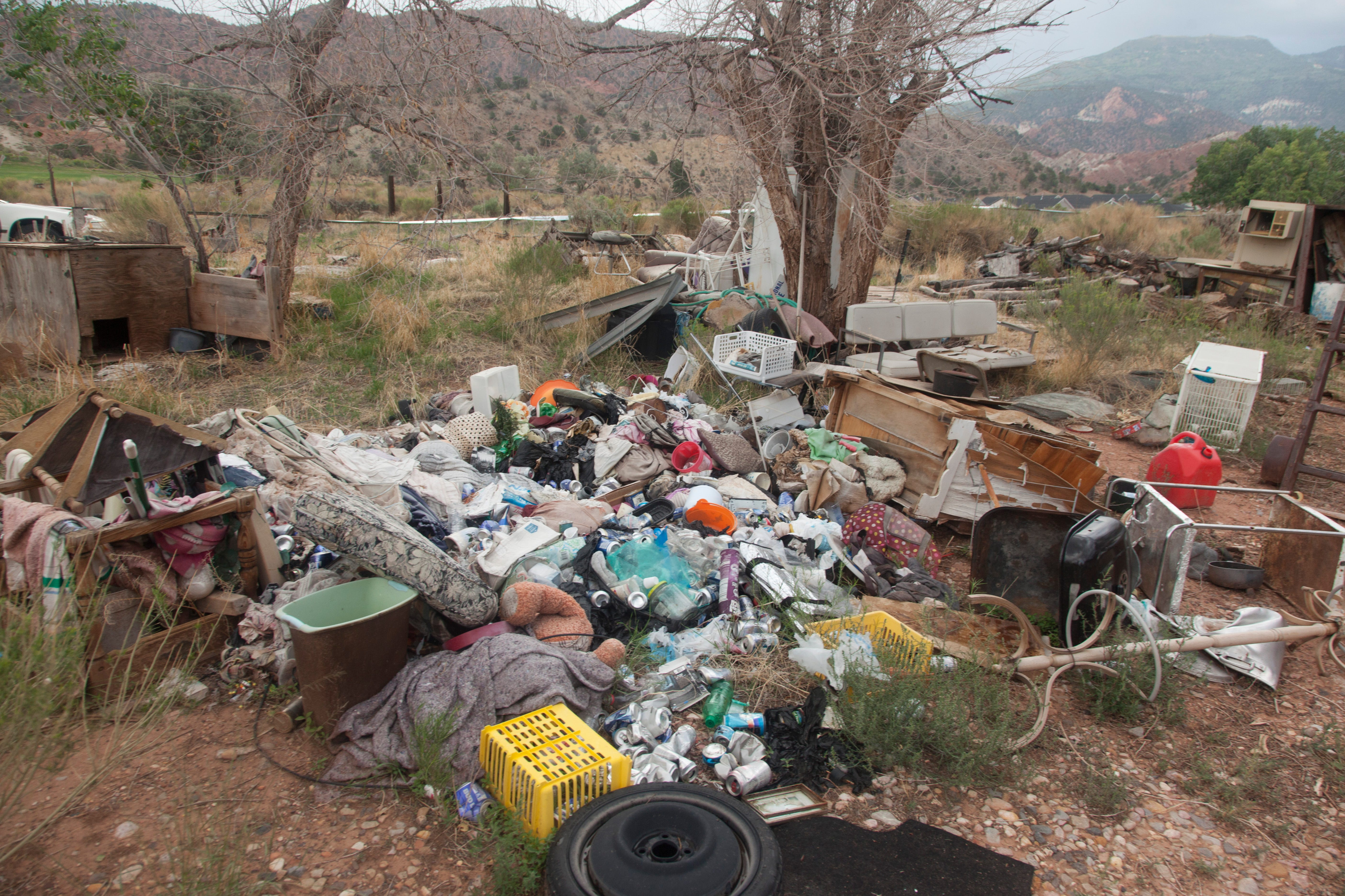 Despite the efforts of a few locals, unoccupied homes have become vulnerable to break-ins and illegal dumping in the Paiute reservation in Cedar City on Aug. 18.