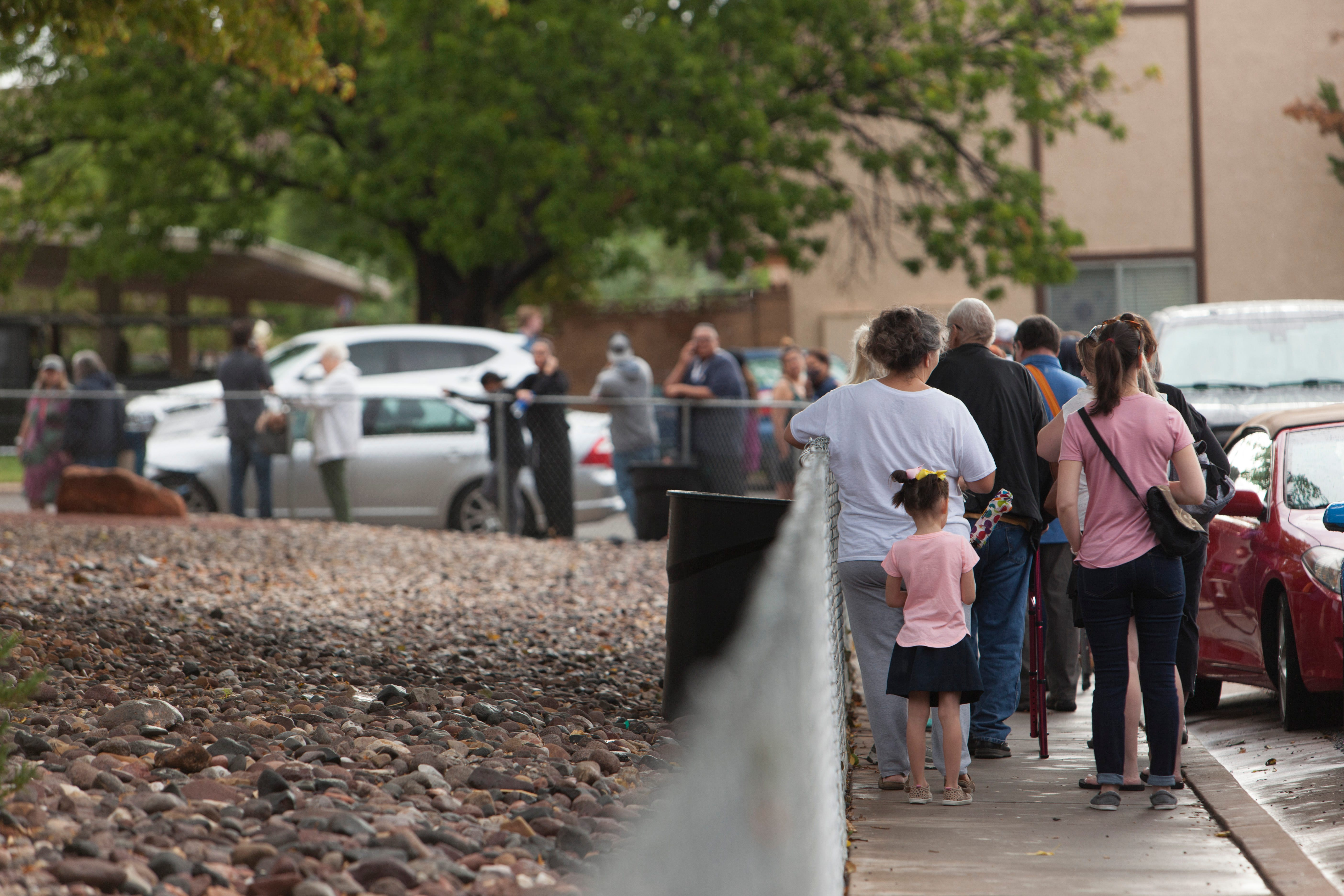 St. George residents file into the St. George Housing Authority to apply for housing assistance Wednesday, Sept. 1, 2021. Some waited through the night in raincoats and camp chairs to hold their spots in line.