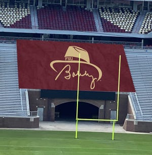This banner showing legendary FSU coach Bobby Bowden's signature and iconic hat will be displayed inside Doak Campbell Stadium this season.