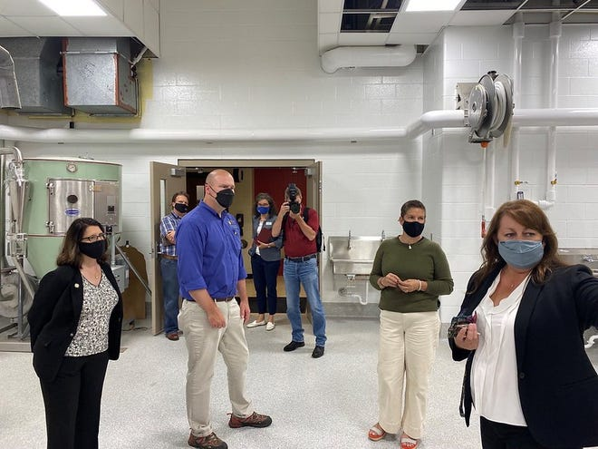 Officials from DATCP and WEDC visited the dairy pilot plant at UW-River Falls this week.