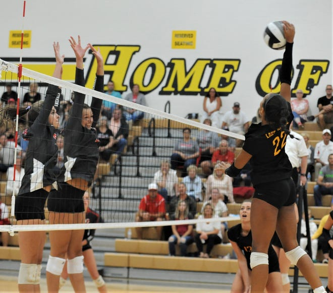 Tri-Valley's Lexi Howe hits a kill across the net against Sheridan earlier this season. Both teams were awarded the top seeds in their respective district volleyball tournaments on Sunday.