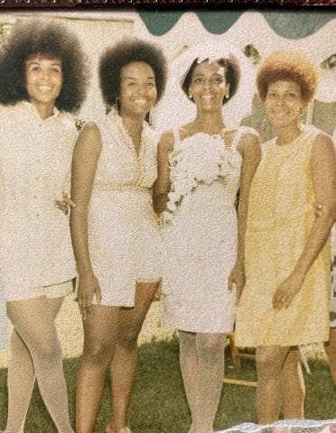 """Ethel Sawyer Adolphe is joined at her wedding in St. Louis in 1971 by other former Tougaloo College students  Dorie Ladner (far left), Joyce Ladner and Janice Jackson Vails.  Adolphe and Sawyer were among the nine Tougaloo students to stage a """"read-in'' at a whites-only library in 1961. The Ladner sisters went on to work with the Student Nonviolent Coordinating Committee."""