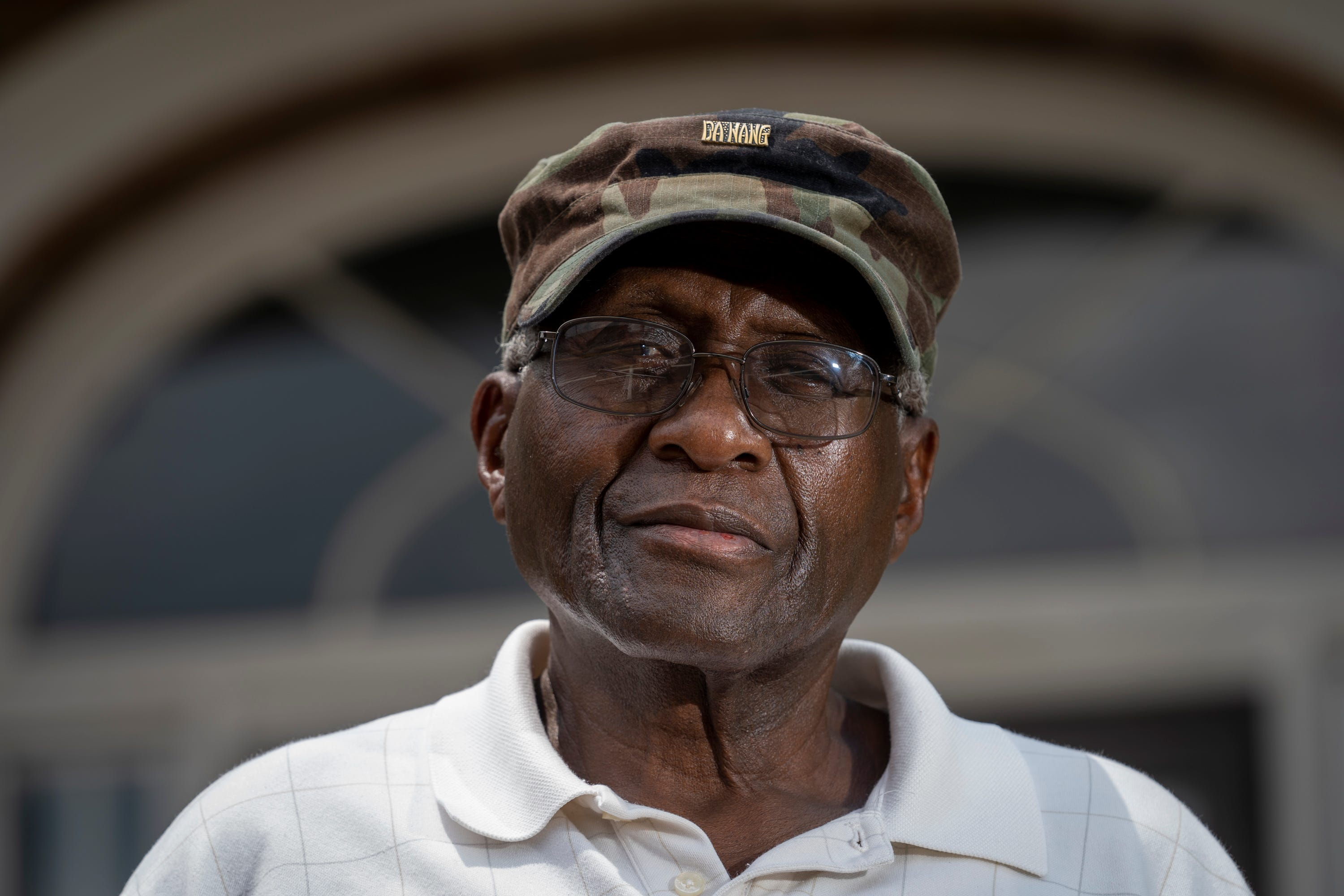 """Robert """"Bobby"""" Talbert, who was arrested in 1961 for sitting in the whites-only section of a Greyhound bus station, stands for a portrait on the front steps of McComb City Hall in Mississippi."""