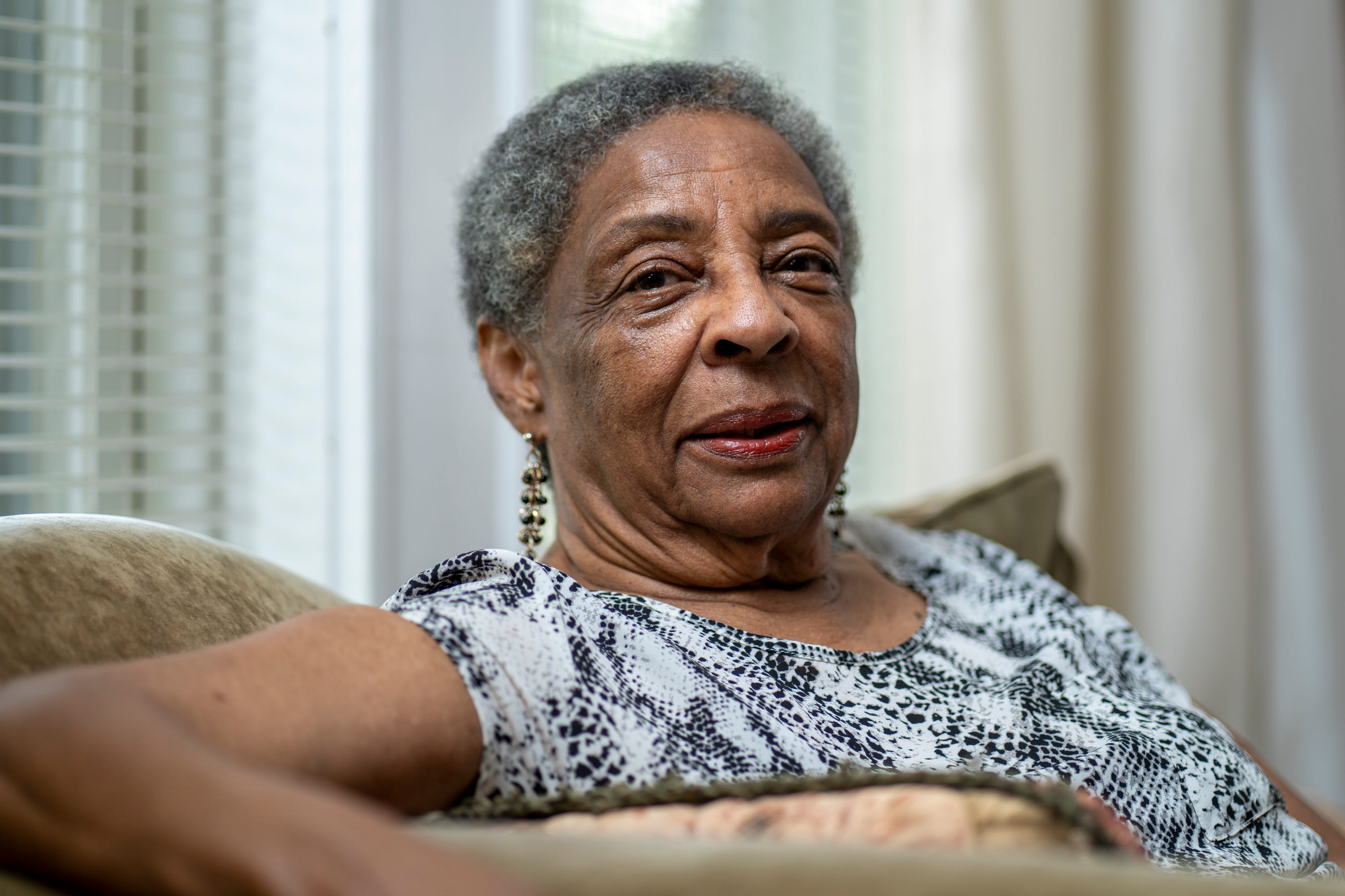 """August 1, 2021; St. Louis, Mo., USA; August 1, 2021; St. Louis, Mo.; Ethel Sawyer Adolphe, one of the Tougaloo Nine students who demonstrated in the sit-in at Jackson Municipal Library, sits for a portrait in her living room.On March 27, 1961, nine Black college students sat at a table in the """"whites only'' public library in Jackson, Mississippi. They were quickly arrested, sparking a campaign that would energize the community and students at other black colleges in Mississippi to hold prayer vigils, boycotts and marches against segregation. Experts said the effort would also help mobilize young activists in other states.. Mandatory Credit: Jasper Colt-USA TODAY ORG XMIT: USAT-458442 [Via MerlinFTP Drop]"""