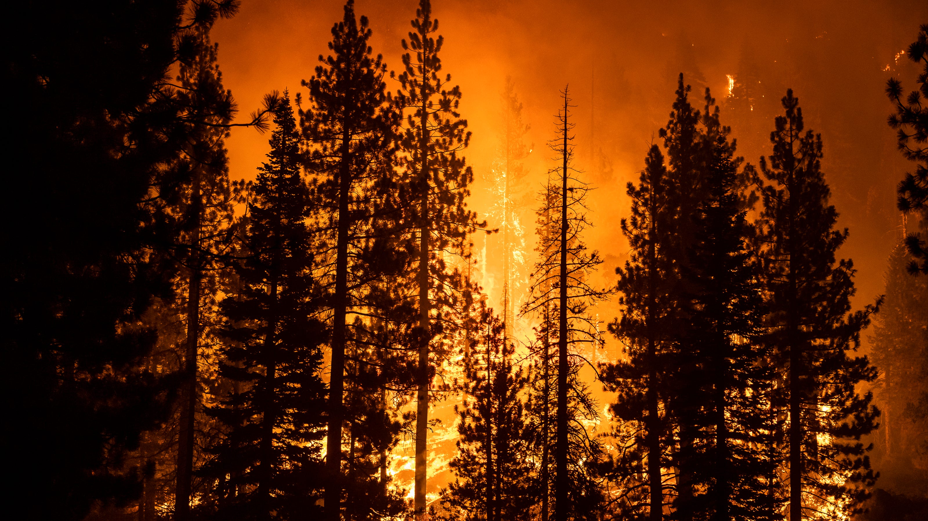 Smoke created by the Caldor Fire obscures a mountain off U.S. Highway 89 near Meyers, Calif., on Aug. 30.