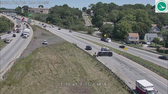 This view, looking east at the Central Interchange in Akron, shows emergency vehicles on I-76 westbound (upper left) leading to the ramp to Route 8 north, as well as on I-76 eastbound, (foreground).
