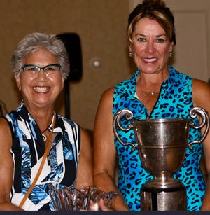 Sharon Bakke (L) of Chagrin Falls  and Christine Shibley (R) Barrington Golf Club pose with the trophy that originated in 1917. Shibley topped Bakke for the Cleveland Woman's Golf Association Championship title in August.