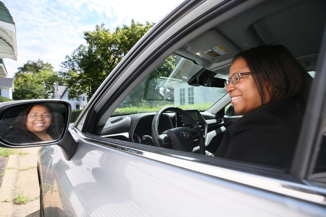 Danielle Morris sits in her new 2020 Toyota Highlander as she talks about the Financial Empowerment Center, a free service run through the city of Akron and United Way of Summit and Medina counties.