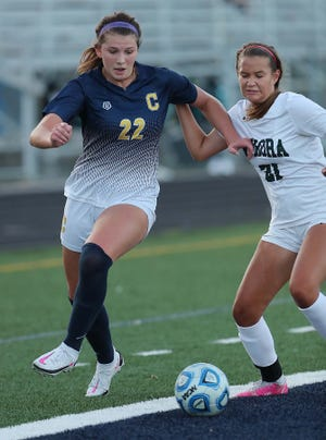 Copley's Ashley Kerekes, left, gets ball past Aurora's Alexandra Sobodosh during the first half of their game at Copley High School Wednesday, Sept. 1, 2021 in Copley, Ohio.