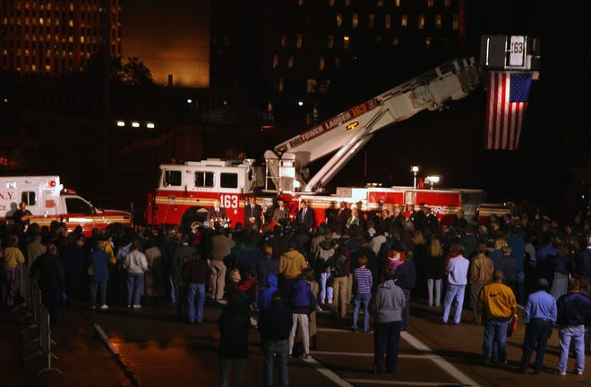 Hundreds gather around a new firetruck and ambulance, purchased for New York City by the people of Greater Akron, during a ceremony Nov. 27,  2001, off Dart Avenue near the Akron Innerbelt.