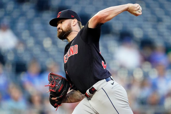 Cleveland starting pitcher Logan Allen throws during the first inning of a baseball game against the Kansas City Royals Wednesday, Sept. 1, 2021, in Kansas City, Mo. (AP Photo/Charlie Riedel)