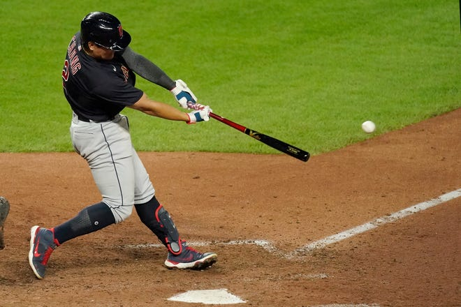 Cleveland's Yu Chang hits an RBI double during the 11th inning of a baseball game against the Kansas City Royals Wednesday, Sept. 1, 2021, in Kansas City, Mo. The Indians won 5-3 in 11 innings. (AP Photo/Charlie Riedel)