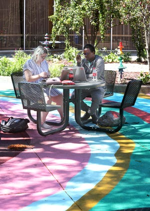 University of Akron students Emily Dale and Taejun Williams study together Thursday in the Schrank Hall courtyard at the University of Akron.