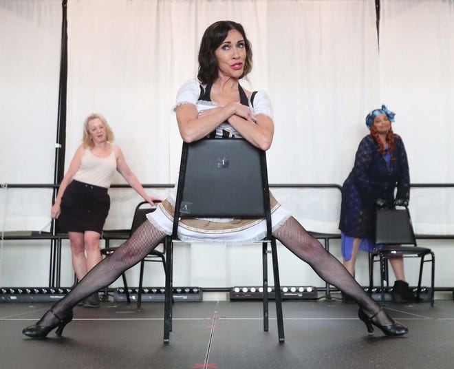 """Tina Davis, portraying lead character Sally Bowles, rehearses with cast members in the BOOM! Theater production of """"Cabaret"""" at the Akron Civic Theatre's Knight Stage Sept. 1."""