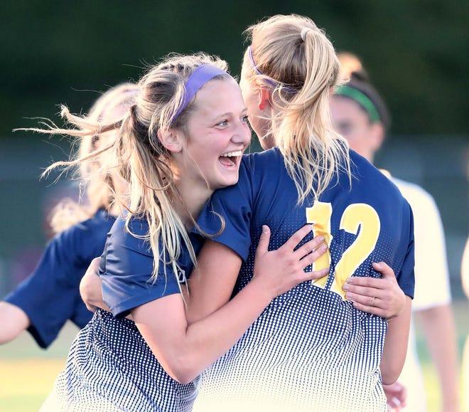 Copley's Emma Niemczura, left, celebrates her goal with teammate Emily Kerekes during the first half of a 5-0 win over Aurora on Wednesday night. [Karen Schiely/Beacon Journal]