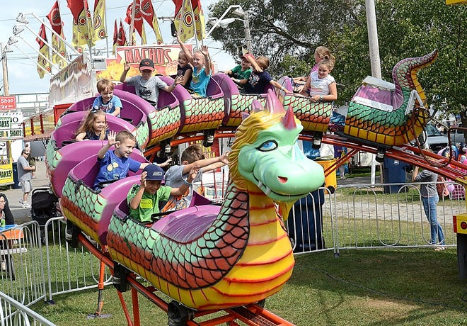 Youngsters ride the Dragon Wagon in August 2017 during the Canfield Fair.