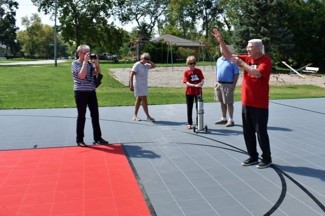 Gary Thompson shows his shooting form from the 3-point line of the renovated basketball court in Roland.