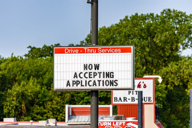 Now hiring sign outside Arby's in Bartlesville.