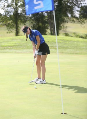 Boonville junior Leah Ziegelbein putts on the No. 2 green Tuesday at Hail Ridge Golf Course in Boonville. The Boonville Lady Pirates golf team played Southern Boone to a tie at 184-184 in the conference opener.