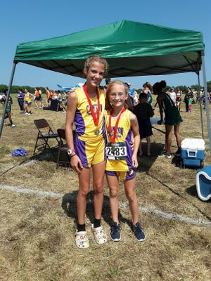 Liva Knowles and Claire Fournier are pictured with their medals.
