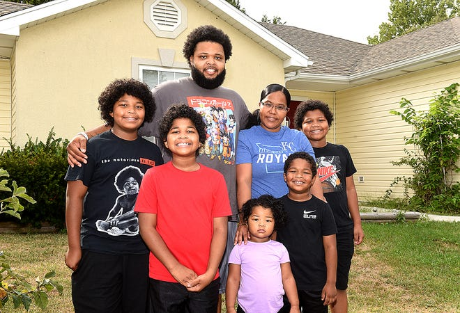 Jiawian Walker, his wife, Shannon, and their children, from left, Jayceon, 12, Junior, 10, Jianna, 2, Joell, 5 and Justice, 9, have benefited from Love Columbia's Extra Mile program, which provides transitional housing for people seeking housing.