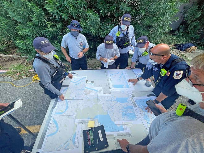Missouri Task Force 1 and Ohio Task Force 1 members prepare for search assessment, reconnaissance and rescue operations Wednesday in Jefferson Parish, Louisiana.