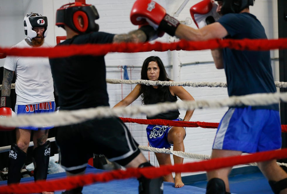 Short North Muay Thai owner Hope Vitellas keeps an eye on students practicing at her Grandview Heights-area gym. Vitellas was recently the only woman head coach at a national competition where her fighters brought home five championship belts.