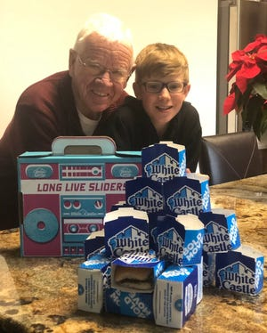 Richard Sorensen, 76, of Upper Arlington, poses in front of a White Castle order with his grandson, Sean Smole, 13.