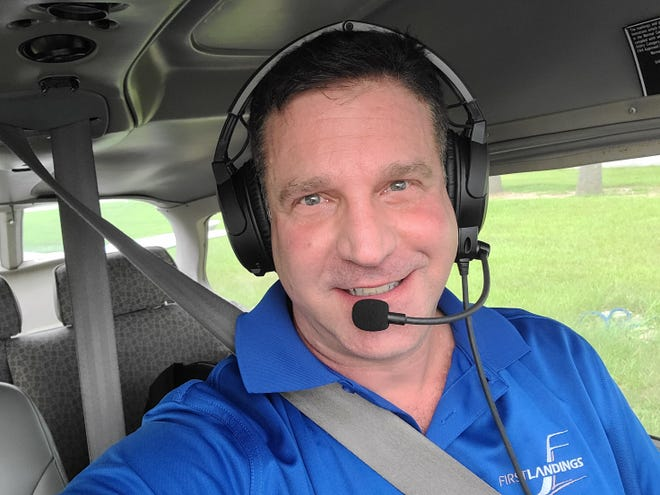 """Dave Cohen, who sets the alarm for """"zero dark thirty"""" to drive from Winter Garden to Eustis High School each day, gets tremendous satisfaction in introducing his Panther students to the joys of aviation."""