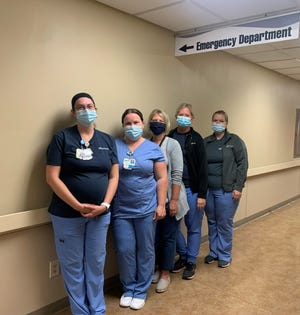 Pomerene Hospital Emergency Room nurses, from left, Shelby Murphy, Jamie Nolen, Jenny Wolfe, Hollie Yoder and Natalie Kolp are among the staff that helped earn the national recognition from the American Heart Association and the NorthCoast 99 distinction in Northeast Ohio.