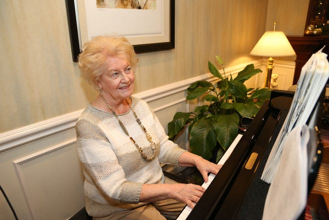 Kathy Kauffman enjoys playing the piano in the main lobby for residents of Beaumont Commons in Dearborn.