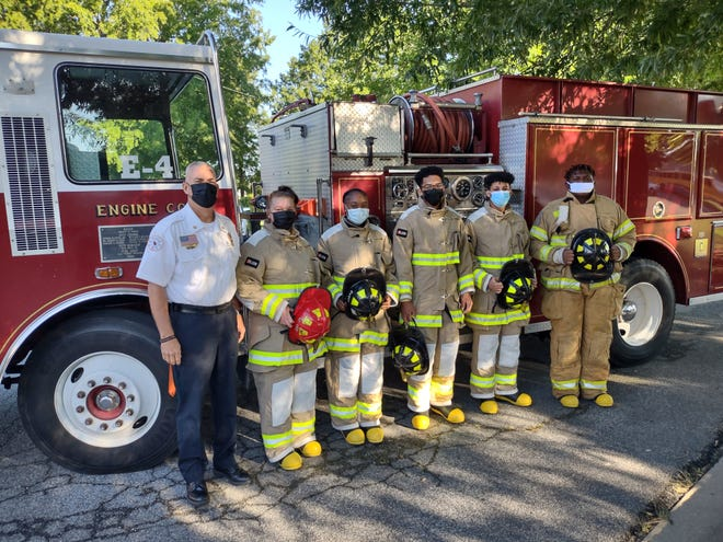 Former Fire Chief Phil Hartley is pictured with students in his Fire Tech I class in front of the fire truck which was donated to Lexington Senior High School by the City of Lexington.