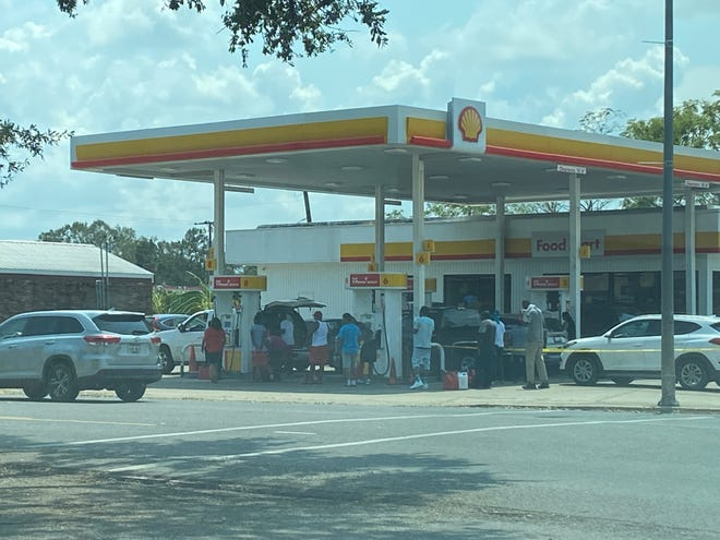Long lines continued to form Sept. 2 at the Shell station on Marchand Drive in Donaldsonville.