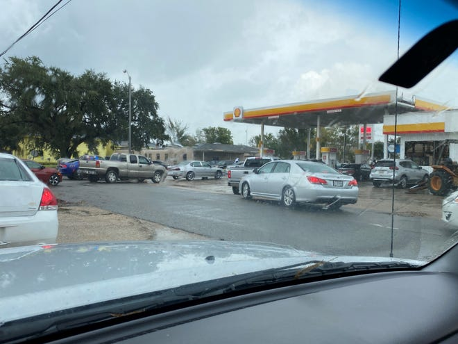 Vehicles line up for fuel at the Shell station in Donaldsonville late Sept. 1.