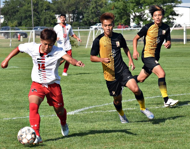 Southeastern Community College's Reona Fuji (14) dribbles toward the goal while two Indian Hills players pursue at the Burlington Regional RecPlex Wednesday. The match ended in a 2-2 deadlock in two overtimes.